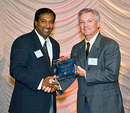 President Deepal S. Eliatamby, P.E., SCCED, accepts the 2012 Roaring Twenties award for being one of South Carolina's fastest growing businesses.