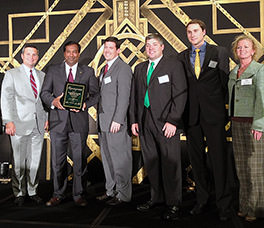 President Deepal S. Eliatamby, P.E., SCCED, and Alliance Consulting Engineers, Inc. staff accept the 2013 Roaring Twenties award for being one of South Carolina's fastest growing businesses.